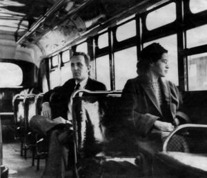 Rosa Parks rides a Montgomery, Ala., bus after the city was forced to stop separating black and white riders. (source: Associated Press)
